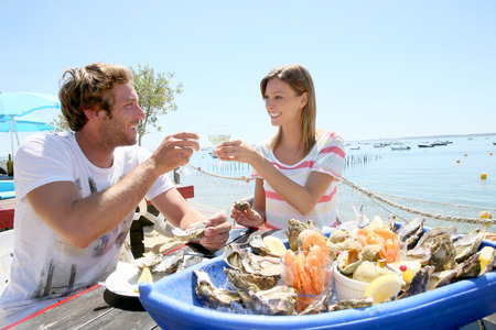 Sheepshead Bay Tourists in Restaurant Dining on Fish